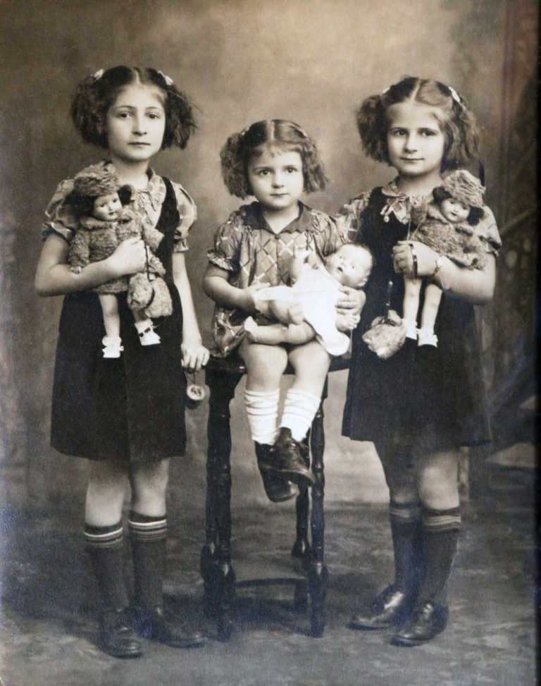 Three Girls and their dolls